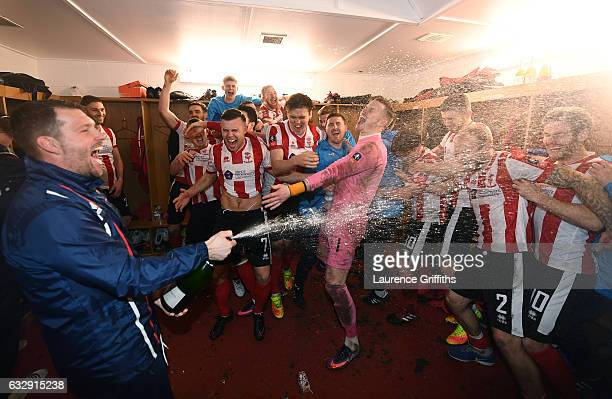 Lincoln City players celebrate their win in the dressing room after the Emirates FA Cup Fourth Round match between Lincoln City and Brighton and Hove...