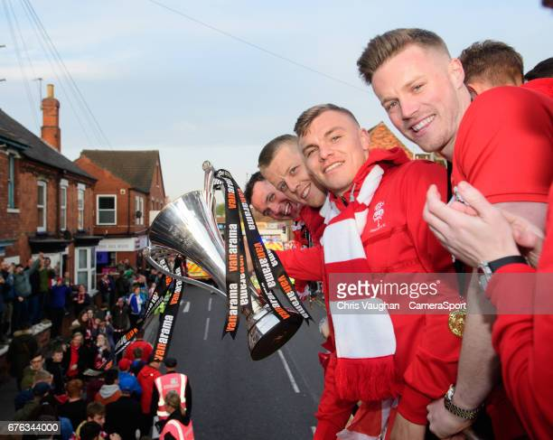 Lincoln City players from left Lee Beevers Terry Hawkridge Harry Anderson and Paul Farman pose for a photograph with a trophy during the Lincoln City...