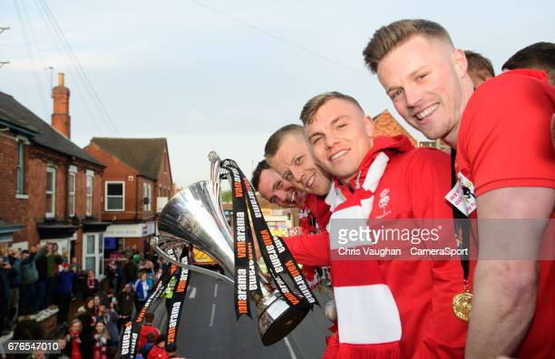 Lincoln City players from left Lee Beevers Terry Hawkridge Harry Anderson and Paul Farman pose for a photograph with the trophy during the Lincoln...
