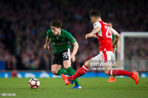 Lincoln City's Alex Woodyard evades the challenge of Arsenal's Granit Xhaka during the Emirates FA Cup QuarterFinal match between Arsenal and Lincoln...