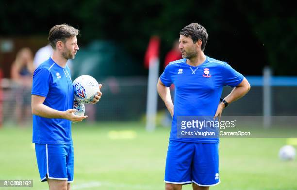 Lincoln City's assistant manager Nicky Cowley left and Lincoln City manager Danny Cowley during the prematch warmup prior to the preseason friendly...