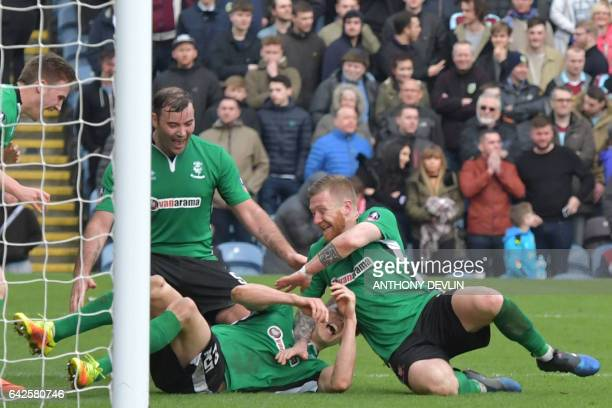 Lincoln City's English defender Sean Raggett celebrates with Lincoln City's Irish midfielder Alan Power after scoring during the English FA Cup fifth...