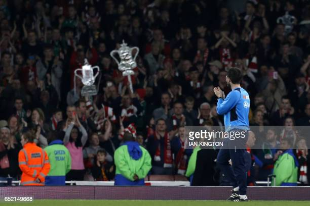 Lincoln City's English manager Danny Cowley applauds their supporters after the English FA cup quarter final football match between Arsenal and...