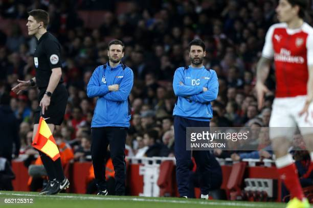 Lincoln City's English manager Danny Cowley stands with his brother and assistant Nicky on the touchline during the English FA cup quarter final...