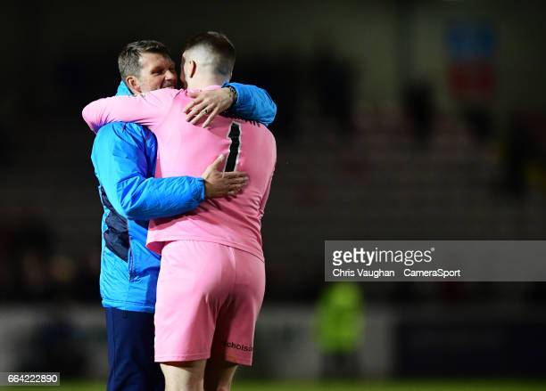 Lincoln City's goalkeeping coach Jimmy Walker left and Lincoln City's Paul Farman at the end of the Vanarama National League match between Lincoln...