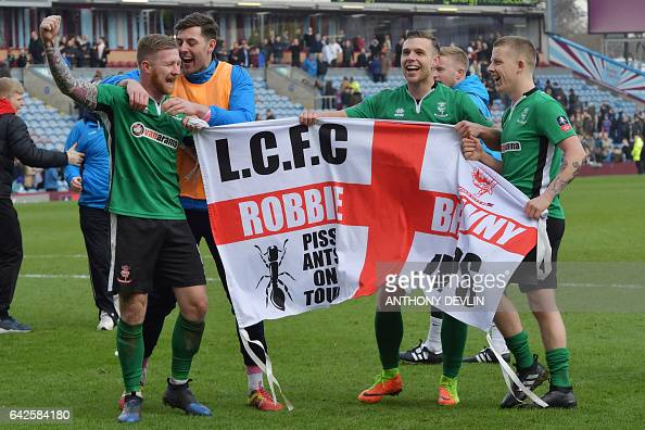 Lincoln City's Irish midfielder Alan Power and Lincoln City's English midfielder Terry Hawkridge celebrate after winning the English FA Cup fifth...