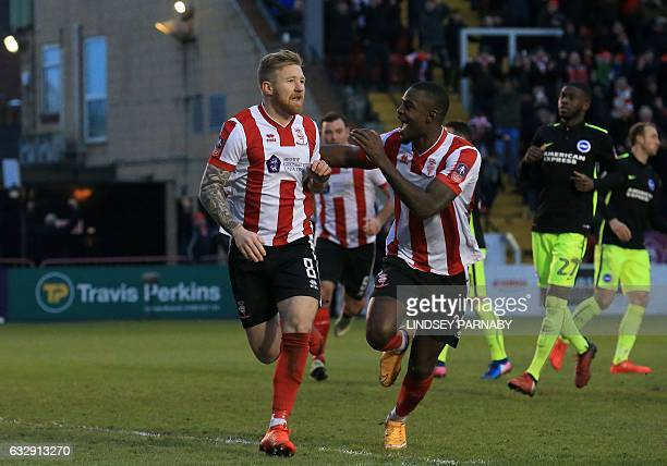 Lincoln City's Irish midfielder Alan Power celebrates scoring his team's first goal from the penalty spot during the English FA Cup fourth round...