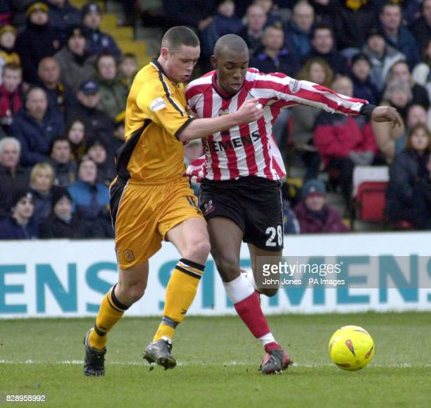 Lincoln City's Marcus Richardson and Hull's Damien Delaney during the Nationwide Division Three match at Sincil Bank Lincoln Saturday February 28...