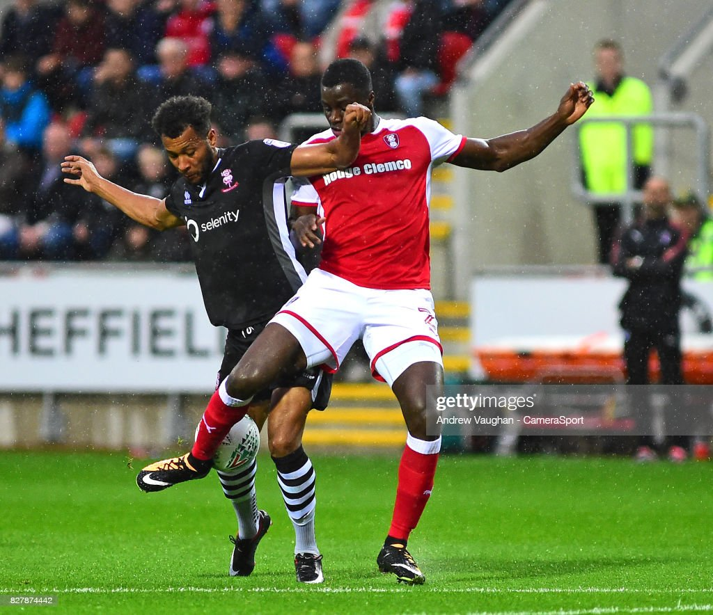 Lincoln City's Matt Green vies for possession with Rotherham Uniteds Josh Emmanuel during the Carabao Cup First Round match between Rotherham United and Lincoln City at Millmoor Ground on August 8, 2017 in Rotherham, England.