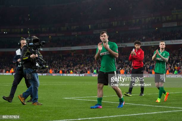 Lincoln City's Matt Rhead applauds the away fans after the Emirates FA Cup QuarterFinal match between Arsenal and Lincoln City at Emirates Stadium on...