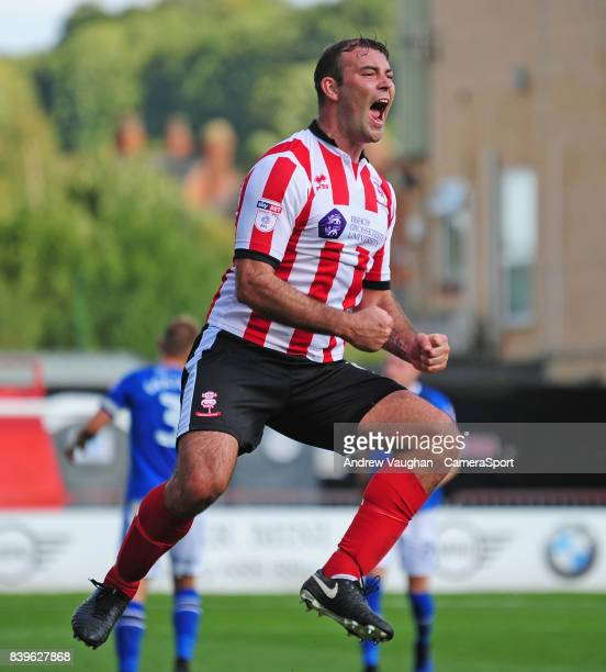 Lincoln City's Matt Rhead celebrates scoring his sides third goal during the Sky Bet League Two match between Lincoln City and Carlisle United at...