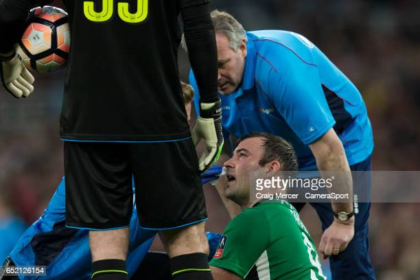 Lincoln City's Matt Rhead gets treatment after taking an elbow to the face during the Emirates FA Cup QuarterFinal match between Arsenal and Lincoln...