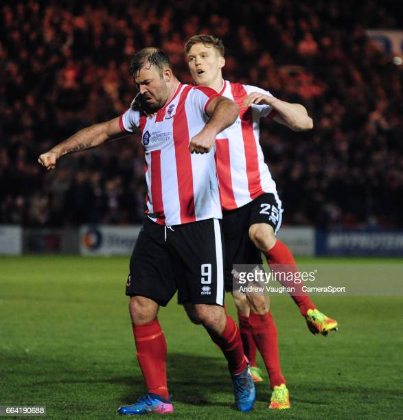 Lincoln City's Matt Rhead left celebrates scoring his sides second goal with teammate Sean Raggett during the Vanarama National League match between...