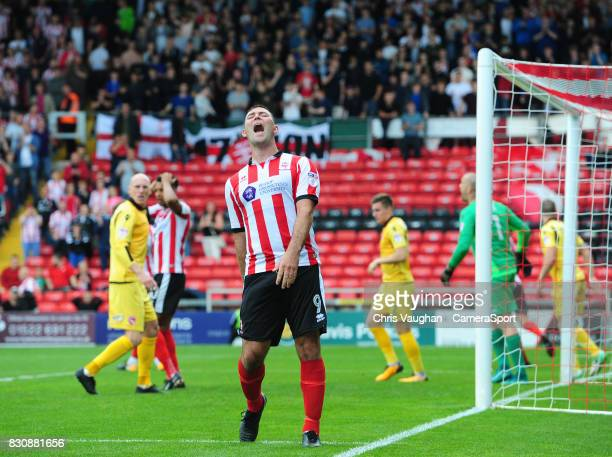 Lincoln City's Matt Rhead reacts after a chance wasn't converted during the Sky Bet League Two match between Lincoln City and Morecambe at Sincil...