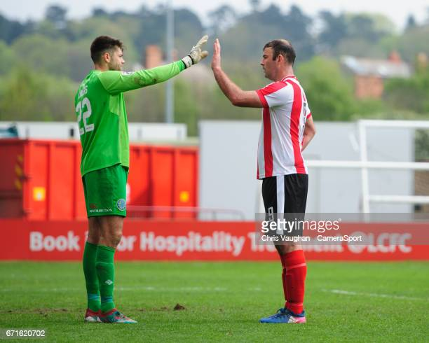 Lincoln City's Matt Rhead right attempts to distract Macclesfield Town's Scott Flinders during the Vanarama National League match between Lincoln...