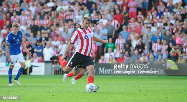 Lincoln City's Matt Rhead scores his sides third goal from the penalty spot during the Sky Bet League Two match between Lincoln City and Carlisle...
