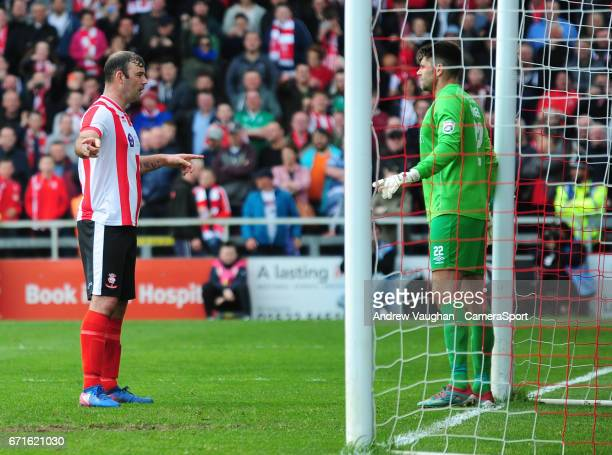 Lincoln City's Matt Rhead tries to disrupt Macclesfield Town's Scott Flinders setting his wall during the Vanarama National League match between...