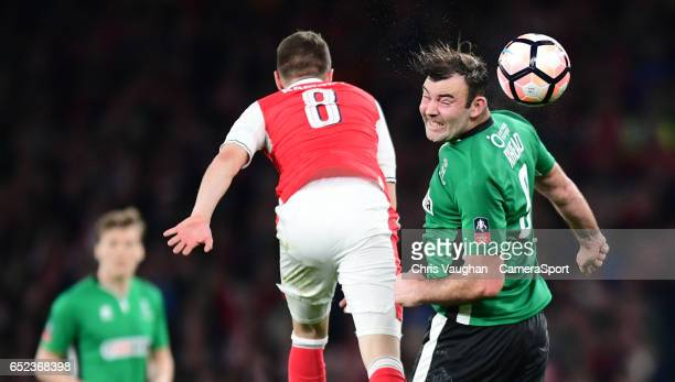 Lincoln City's Matt Rhead vies for possession with Arsenal's Aaron Ramsey during the Emirates FA Cup QuarterFinal match between Arsenal and Lincoln...