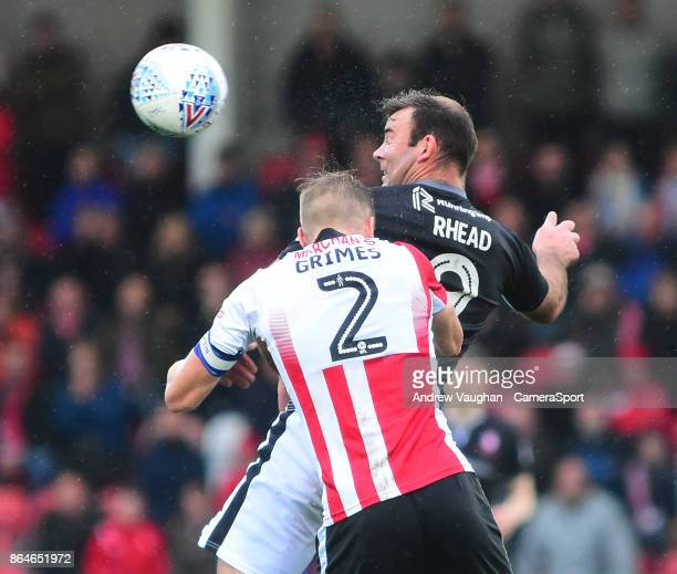 Lincoln City's Matt Rhead vies for possession with Cheltenham Town's Jamie Grimes during the Sky Bet League Two match between Cheltenham Town and...