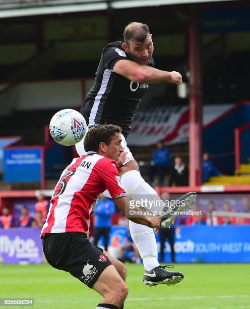 Lincoln City's Matt Rhead vies for possession with Exeter City's Craig Woodman during the Sky Bet League Two match between Exeter City and Lincoln...