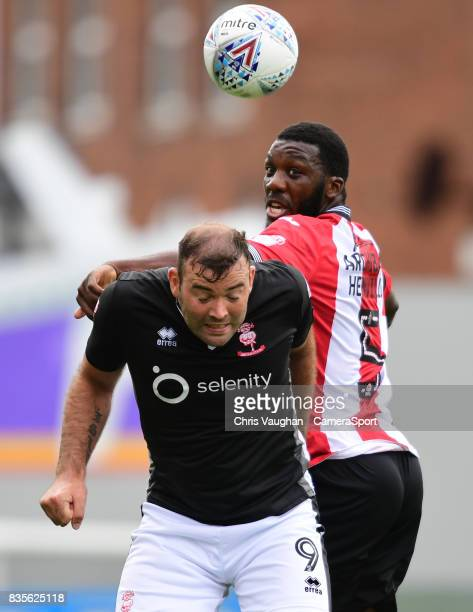 Lincoln City's Matt Rhead vies for possession with Exeter City's Troy ArchibaldHenville during the Sky Bet League Two match between Exeter City and...