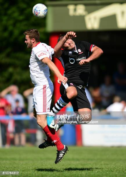 Lincoln City's Matt Rhead vies for possession with Lincoln United's Sean Wright during the preseason friendly match between Lincoln United and...