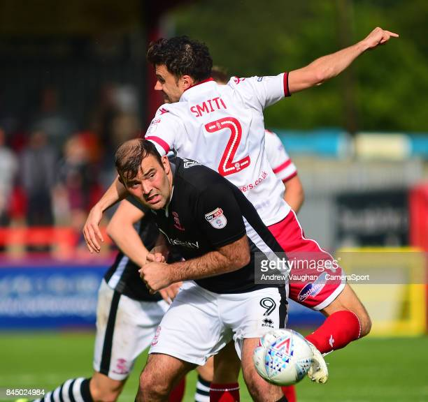 Lincoln City's Matt Rhead vies for possession with Stevenages Jonathan Smith during the Sky Bet League Two match between Stevenage and Lincoln City...