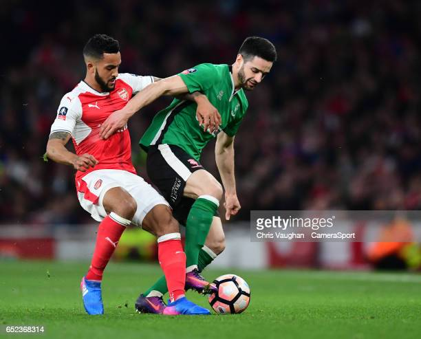 Lincoln City's Sam Habergham shields the ball from Arsenal's Theo Walcott during the Emirates FA Cup QuarterFinal match between Arsenal and Lincoln...