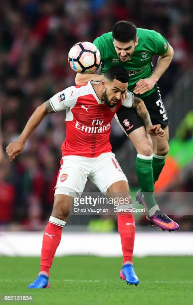 Lincoln City's Sam Habergham vies for possession with Arsenal's Theo Walcott during the Emirates FA Cup QuarterFinal match between Arsenal and...