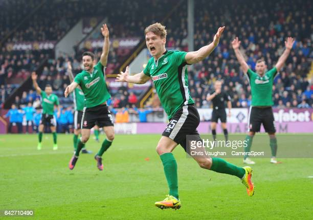 Lincoln City's Sean Raggett celebrates scoring the opening goal during The Emirates FA Cup Fifth Round match between Burnley and Lincoln City at Turf...