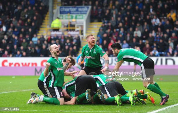 Lincoln City's Sean Raggett celebrates scoring the opening goal with teammates during The Emirates FA Cup Fifth Round match between Burnley and...
