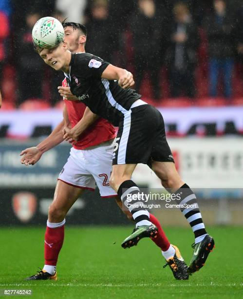 Lincoln City's Sean Raggett vies for possession with Rotherham United's Kieffer Moore during the Carabao Cup First Round match between Rotherham...