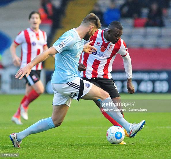 http://media.gettyimages.com/photos/lincoln-citys-theo-robinson-vies-for-possession-with-aldershot-towns-picture-id622839782?s=594x594