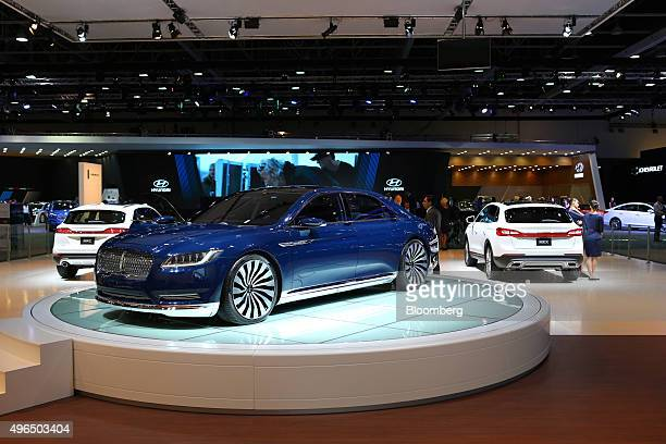 A Lincoln Continental luxury sedan manufactured by the Lincoln division of Ford Motor Co sits on display stand during the Dubai Motor Show at the...