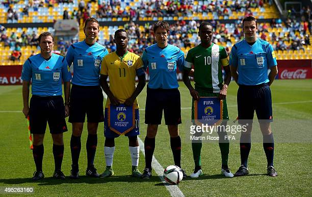 Lincoln of Brazil and Kelechi Nwakali of Nigeria line up with the match officals before the FIFA U17 Men's World Cup 2015 quarter final match between...