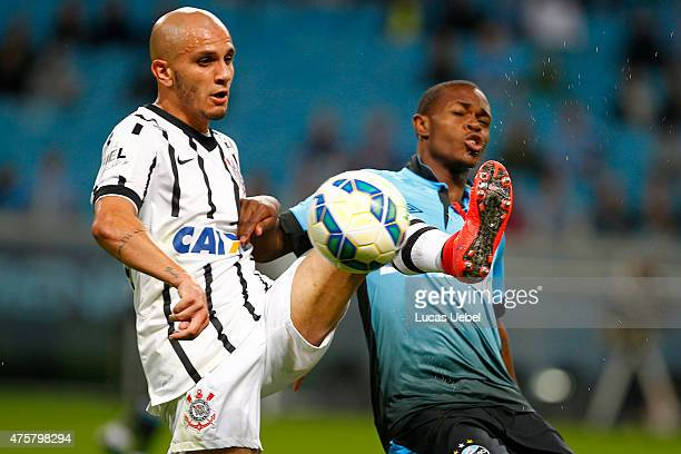 Lincoln of Gremio battles for the ball against Fabio Santos of Corinthians during the match Gremio v Corinthians as part of Brasileirao Series A 2015...