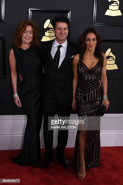 Lincoln Trio arrives for the 59th Grammy Awards pretelecast on February 12 in Los Angeles California / AFP / Mark RALSTON