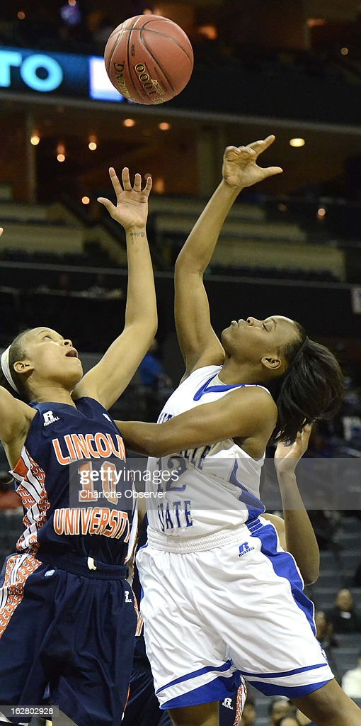 Lincoln University's Brittney Waters, left, reaches for a rebound with Fayetteville State's Je'Lena Robertson in CIAA Tournament action on Wednesday, February 27, 2013, at Time Warner Cable Arena in Charlotte, North Carolina. Fayetteville State advanced to the semifinals, 60-46.