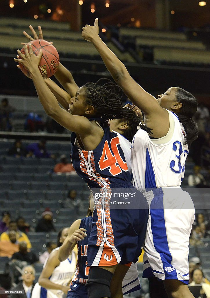Lincoln University's Tahlar McIntosh (40) pulls down a rebound against Fayetteville State's Tierra Coleman, right, in CIAA Tournament action on Wednesday, February 27, 2013, at Time Warner Cable Arena in Charlotte, North Carolina. Fayetteville State advanced to the semifinals, 60-46.