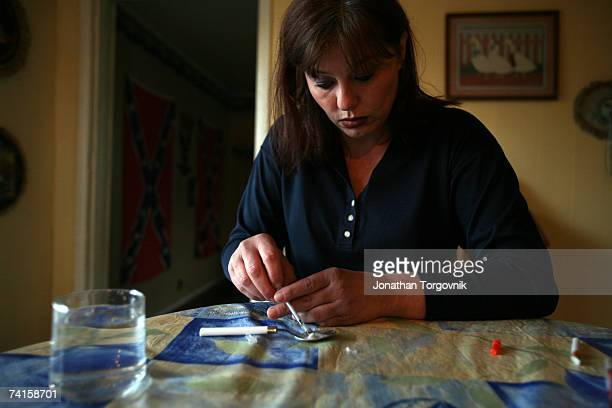 Linda at Sandy's house preparing her Meth to inject on November 30 2005 in Bowling Green Kentucky Right after she shot up the Meth she also shoot up...