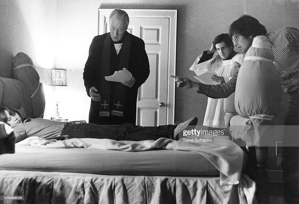 Linda Blair Max von Sydow Jason Miller and William Friedkin rehearse a scene for the film The Excorcist