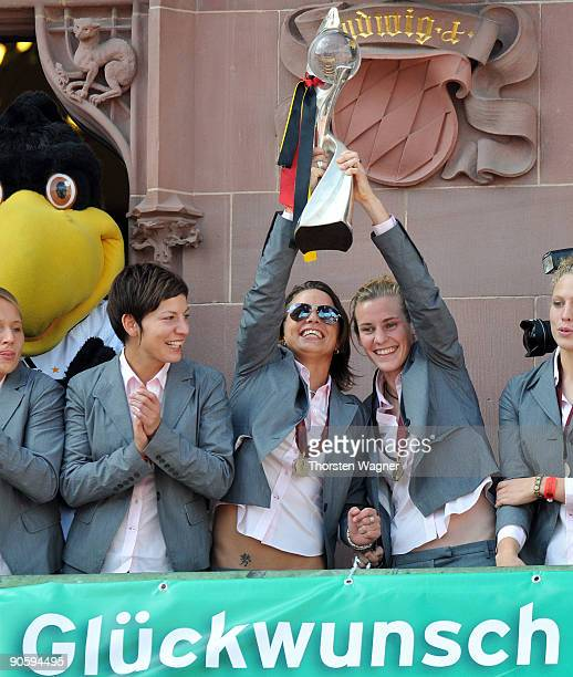 Linda Bresonik Inka Grings and Simone Laudehr show the trophy during the Women's national team celebration of the Euro 2009 victory at the Frankfurt...