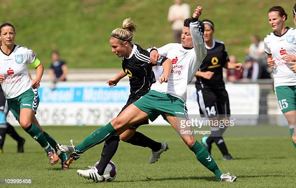 Linda Bresonik of Duisburg challenges Svenja Huth of Frankfurt during the Women's bundesliga match between FCR Duisburg and FFC Frankfurt at the...