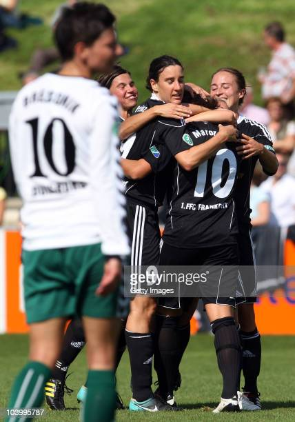 Linda Bresonik of Duisburg disappointed whilst Frankfurt players cheering after their first goal during the Women's bundesliga match between FCR...
