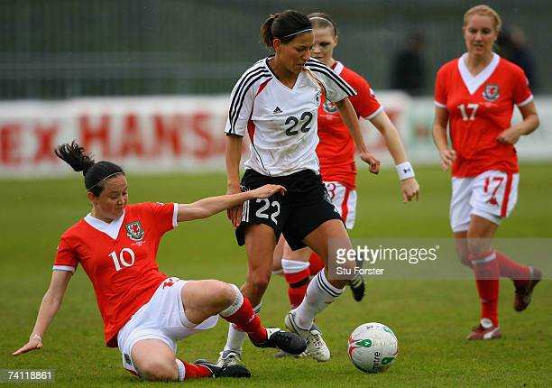 Linda Bresonik of Germany weaves her way through the Welsh defence during the UEFA Womens Championship Qualification Round match between Wales and...