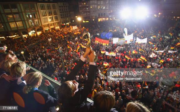 Linda Bresonik of the German Womens National Soccer Team celebrates at the city hall 'Roemer' after returning home from the World Championship...
