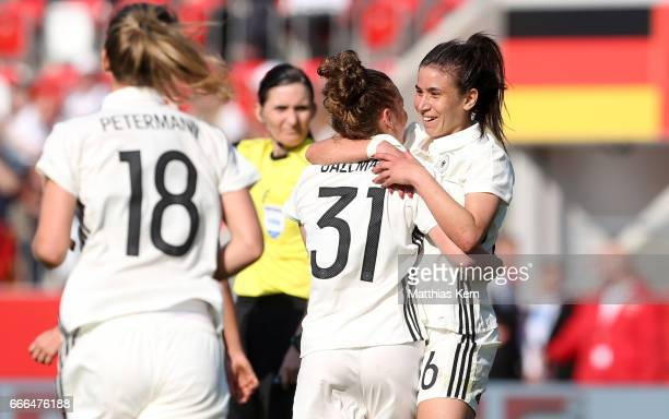 Linda Dallman of Germany jubilates with team mate Hasret Kayikci after scoring the third goal during the women's international friendly match between...
