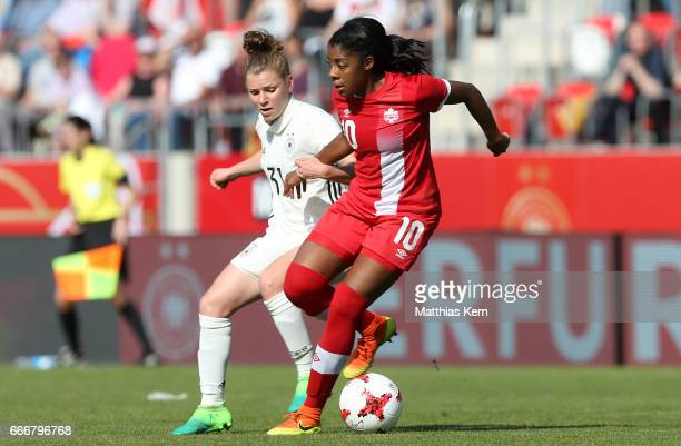 Linda Dallmann of Germany battles for the ball with Ashley Lawrence of Canada during the women's international friendly match between Germany and...