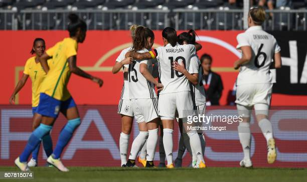 Linda Dallmann of Germany celebrates with her teammates after scoring her team's first goal during the Women's International Friendly match between...