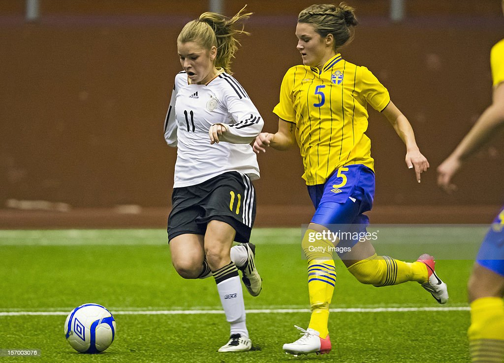 Linda Dallmann (L) of Germany fights for the ball with Saga Fredriksson of Sweden during the Under 19 Women's international friendly between Sweden and Germany at Tipshallen Stadium on November 21, 2012 in Vaxjo, Sweden.